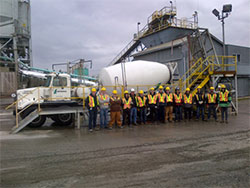 People in front of concrete truck